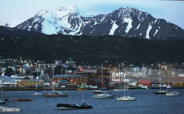 Boats are anchored on October 30 2017 in Ushuaia Argentina Ushuaia is situated along the southern edge of Tierra del Fuego in the Patagonia region...