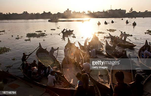 Boats are docked at a ghat November 10 2013 in the Hazaribagh neighborhood of Dhaka Bangladesh Hazaribagh was just listed in a report by Green Cross...