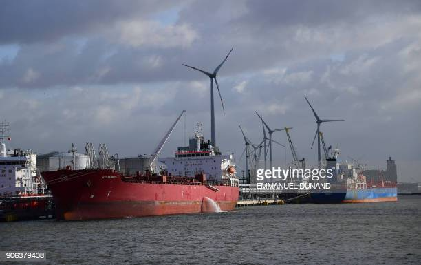 Boats are moored at docks in the Port of Antwerp in Antwerp on January 17 2018 / AFP PHOTO / EMMANUEL DUNAND
