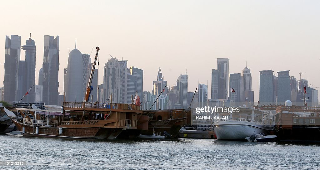 Boats are moored with the Qatari capital Doha skyline in the background on June 25, 2014. Qatar, facing growing corruption allegations over the 2022 World Cup and a backlash over Islamists it supported, finds itself isolated a year after its young emir acceded to the throne.