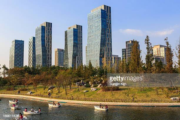 boats are on the lake at the park - songdo ibd stock pictures, royalty-free photos & images