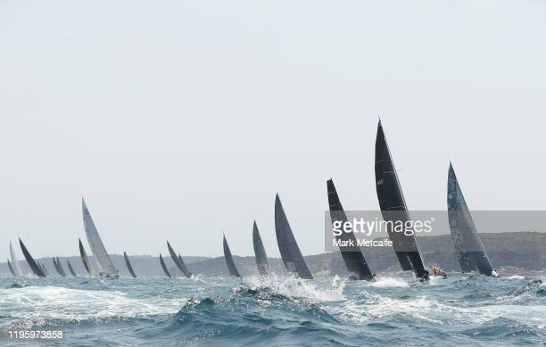 Boats are pictured racing through Sydney heads during the 2019 Sydney to Hobart on December 26 2019 in Sydney Australia
