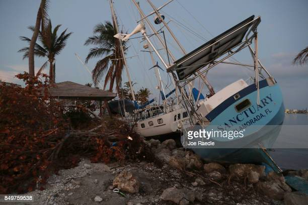 Boats are pushed up along the shore line after hurricane Irma passed through the area on September 19 2017 in Marathon Florida The process of...