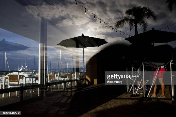 Boats are reflected in a window as voters cast ballots at a polling place on Lido Isle in Newport Beach, California, U.S., on Tuesday, Nov. 6, 2018....