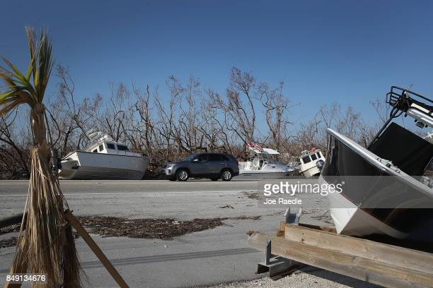 Boats are seen along the Overseas highway after they were deposited there by hurricane Irma as it passed through the area on September 18 2017 in Big...