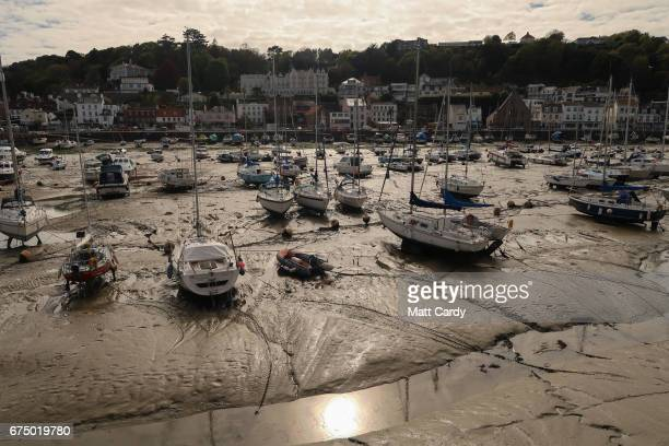 Boats are seen at low tide in the harbour in St Aubin on April 13 2017 near St Helier Jersey Jersey which is not a member of the European Union is...