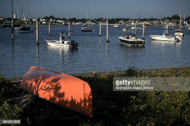 Boats are seen at the moorings in Edgartown Harbor August 19 2015 in Edgartown Massachusetts on Martha's Vineyard AFP PHOTO/BRENDAN SMIALOWSKI