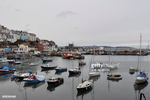 Boats are seen in the harbour in the fishing town of Brixham on the south coast of England on March 26 2018 On the dockside in Brixham a bustling...
