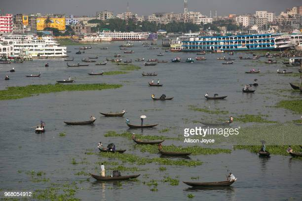 Boats are seen on the Buriganga river on June 5 2018 in Dhaka Bangladesh Bangladesh has been reportedly ranked 10th out of the top 20 plastic...