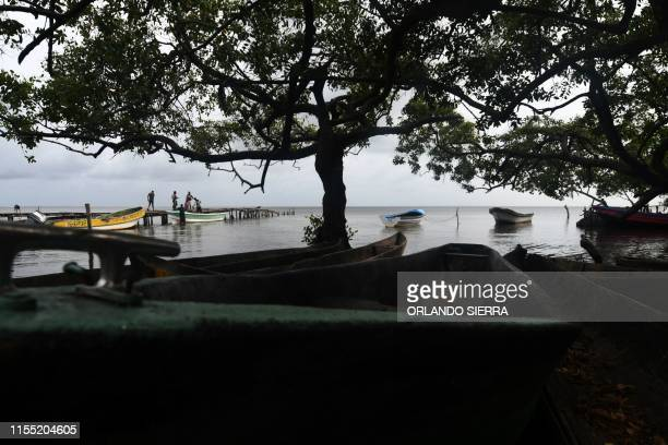 Boats are seen on the shore of Prumnitara Puerto Lempira Honduras on July 8 2019 Thousands of fishing divers of the Mosquitia region where lobster...