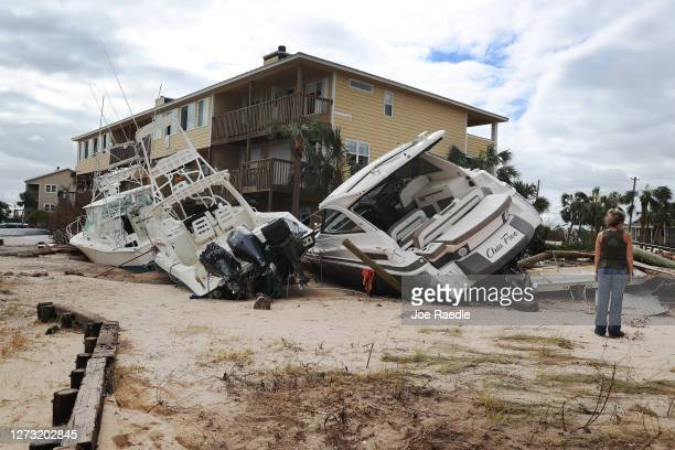 Boats are seen pushed up against a building at Lost Key Marina Yacht Club after Hurricane Sally passed through the area on September 17 2020 in...