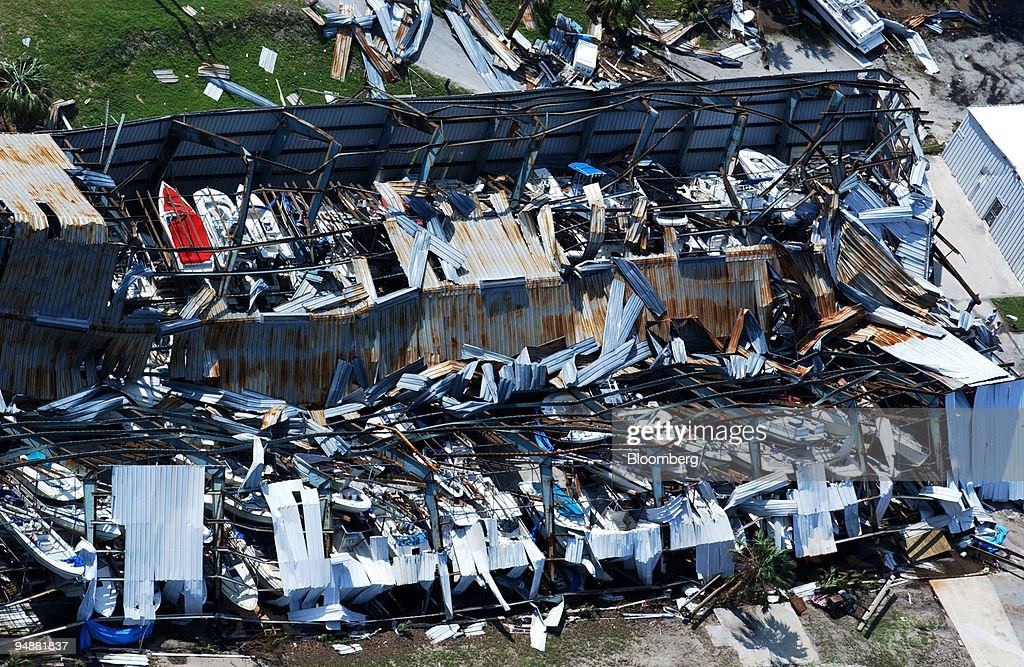 Boats Are Seen, Top Left, In A Marine Storage Building Damaged By Hurricane  Jeanne