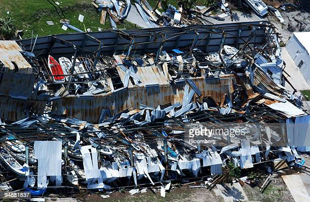Boats are seen, top left, in a marine storage building damaged by Hurricane Jeanne in Port St. Lucie, Florida on Monday, September 27, 2004. Munich...