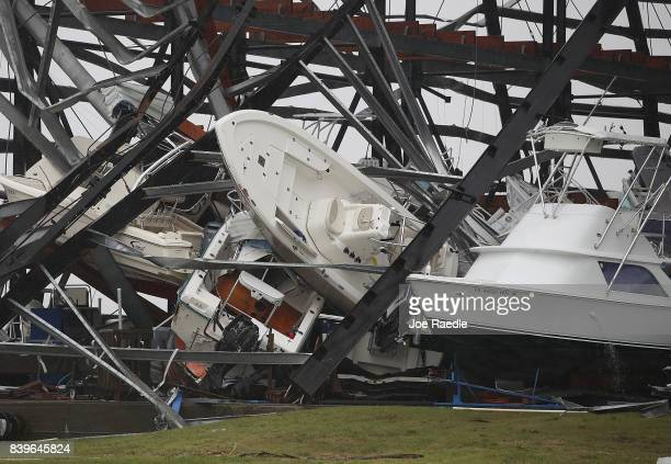 Boats are seen tossed around after Hurricane Harvey passed through on August 26 2017 in Rockport Texas Harvey made landfall shortly after 11 pm...