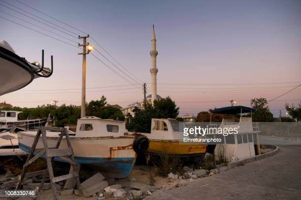 boats at a small shipyard at night. - emreturanphoto stock pictures, royalty-free photos & images