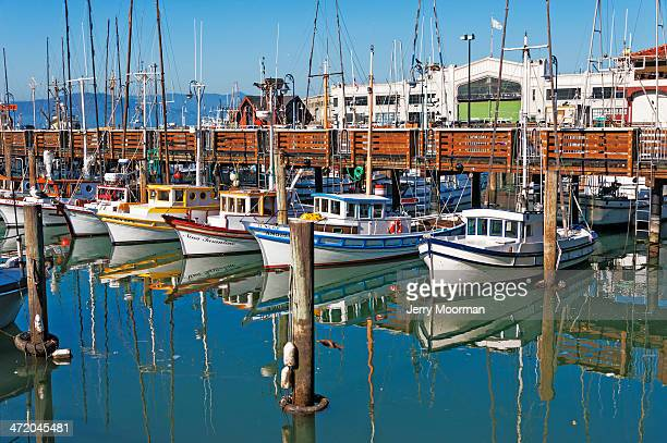 boats at fisherman's wharf - fishermans wharf stock pictures, royalty-free photos & images