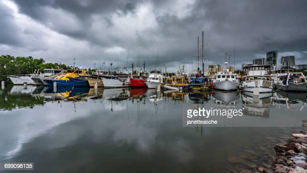 boats at frances bay mooring basin, darwin, northern territory, australia - rainy season stock pictures, royalty-free photos & images