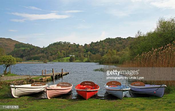boats at grasmere - ambleside stock photos and pictures