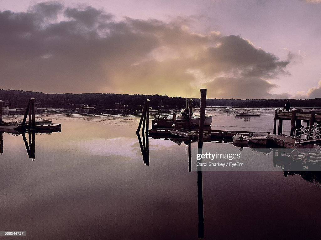 Boats At Harbor Against Sky During Sunset : Stock Photo