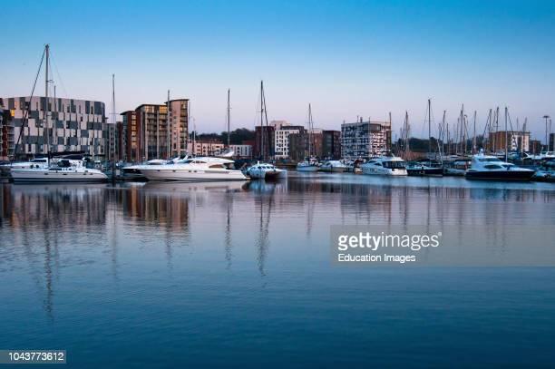 Boats at Ipswich Marina at dusk Suffolk England.