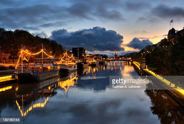 boats at river aura - turku finland stock photos and pictures