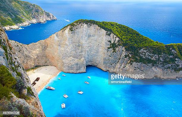boats at shipwreck beach, zakynthos - mediterranean sea stock pictures, royalty-free photos & images