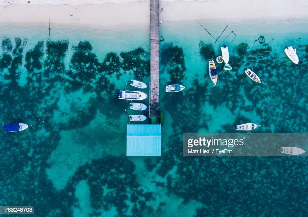boats at shore - mauritius stock photos and pictures
