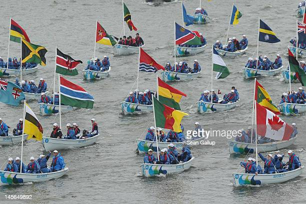 Boats bearing flags of the Commonwealth participate in the River Pageant of the Diamond Jubilee on June 3 2012 in London England For only the second...