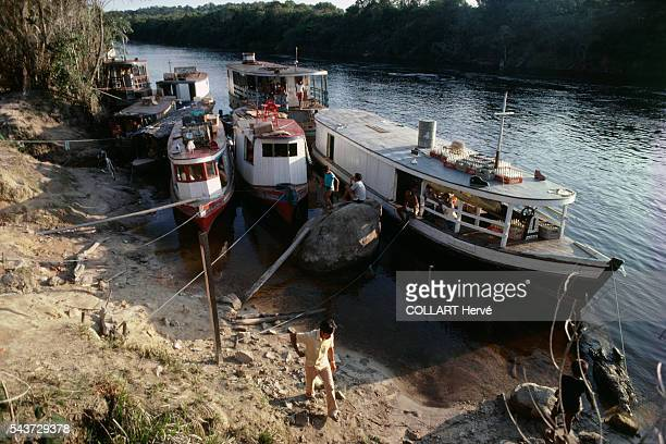 Boats belonging to the Regataoes visiting the Tukanos Indians tied up on the banks of the Amazon