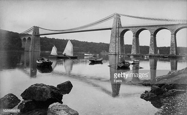 Boats by the Menai Suspension Bridge which links Anglesey and mainland Wales circa 1865 It was the first major suspension bridge in the world built...