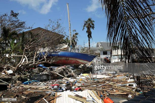 Boats cars and other debris clog waterways in the Florida Keys two days after Hurricane Irma slammed into the state September 12 2017 in Marathon...
