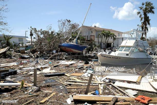 Boats cars and other debris clog waterways in the Florida Keys two days after Hurricane Irma slammed into the state on September 12 2017 in Marathon...