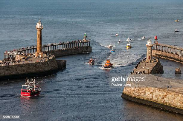 boats coming and going - whitby north yorkshire england stock pictures, royalty-free photos & images