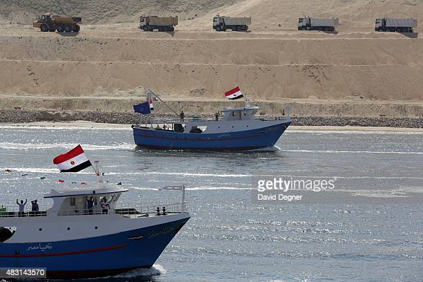 Boats cross the Suez Canal during the opening ceremony of the new Suez Canal expansion including a new 35km channel on August 6, 2015 in Suez, Egypt....