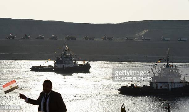 Boats cross the Suez Canal during the opening ceremonyof a new waterway on August 6 in the port city of Ismailiya Egyptian President Abdel Fattah...