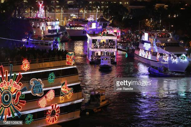Boats decked out with holiday decorations travel along the New River while participating in the 47th annual Seminole Hard Rock Winterfest Boat Parade...