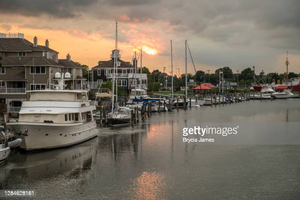 boats docked along the lewes and rehoboth canal - brycia james stock pictures, royalty-free photos & images