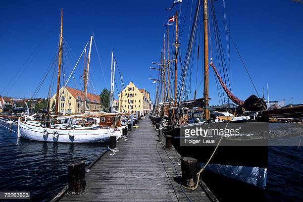 boats docked on pier in svendborg harbor, svenborg, denmark - funen stock pictures, royalty-free photos & images