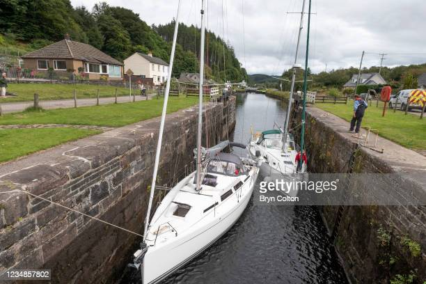 Boats enter the sea locks at gate eight on the Crinan Canal on August 19, 2021 in Cairnbaan, Scotland. Passage along the canal has been reduced as...