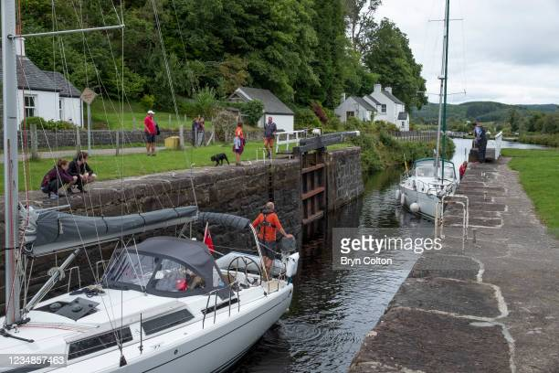 Boats enter the sea locks at gate seven on the Crinan Canal on August 19, 2021 in Cairnbaan, Scotland. Passage along the canal has been reduced as...