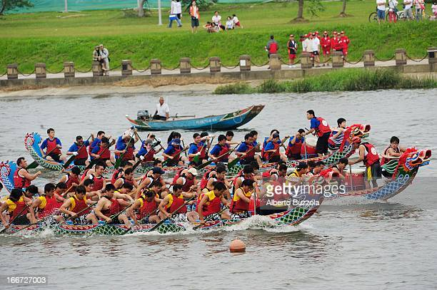 Boats fiercely compete on the Keelung River on the opening day of the annual Dragon Boat Festival a national holiday in Taiwan The dragon boat...