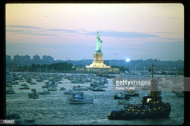 Boats fill New York Bay during the centennial celebration of the Statue of Liberty July 4 1986 in New York City Designed by sculptor FredericAugust...
