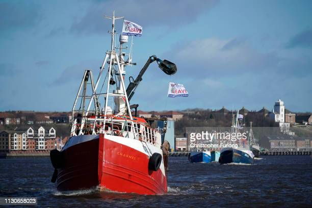 Boats flying proBrexit flags sail on the River Tyne during the Fishing For Leave flotilla on March 15 2019 in North Shields United Kingdom Fishing...