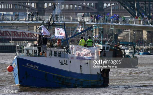 Boats flying proBrexit flags sail on the River Tyne near the Millennium Bridge where counterprotesters have gathered to show their support for the EU...