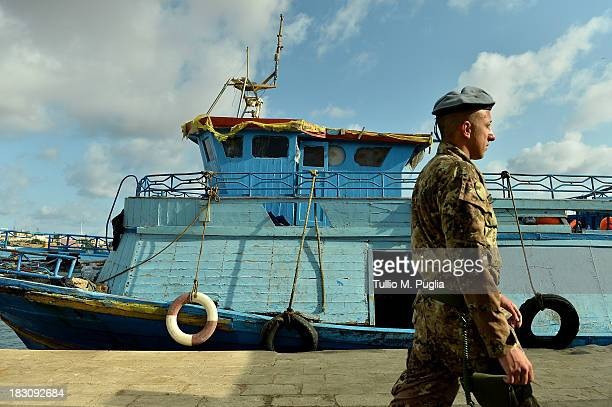 Boats fomerly used by immigrants arriving in Lampedusa lie disused on October 4 2013 in Lampedusa Italy The search for bodies continues off the coast...