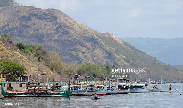 Boats for hire are anchored at the foot of the Taal volcanic island in the town of Talisay Batangas province south of Manila on May 3 as tourist...