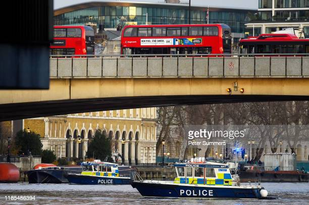 Boats from the Metropolitan Police Marine Policing Unit patrol near the scene after a number of people are believed to have been injured after a...