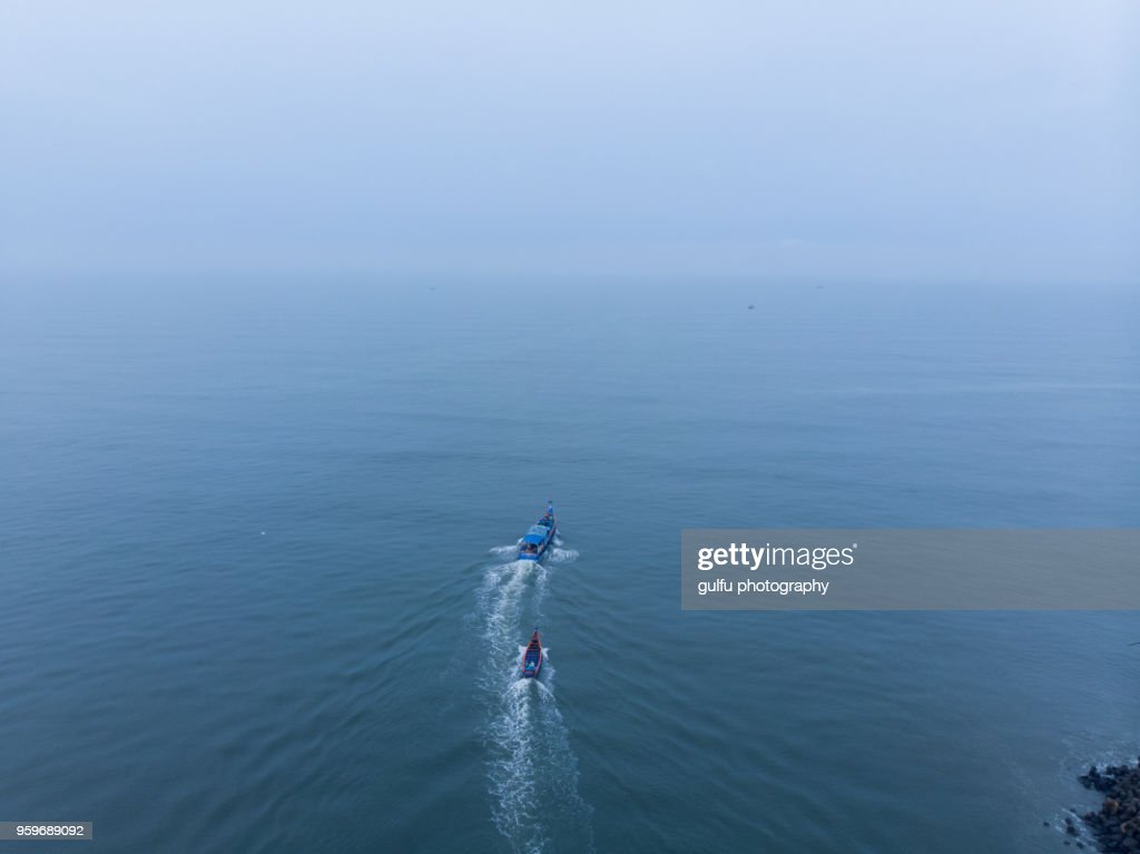 Boats going to deep sea for fishing : Stock Photo