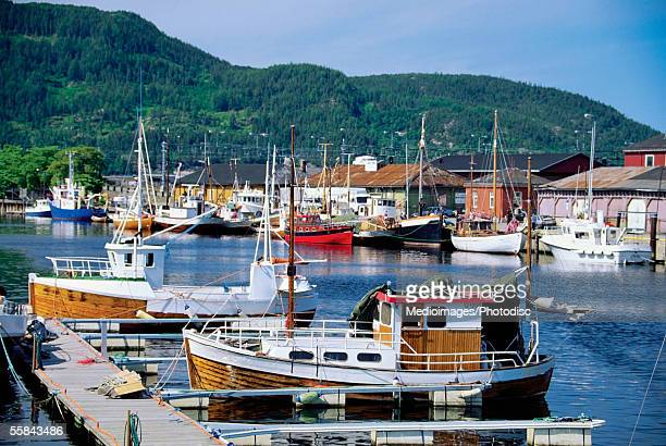 boats in a harbor, oban harbor, scotland - argyll and bute stock photos and pictures