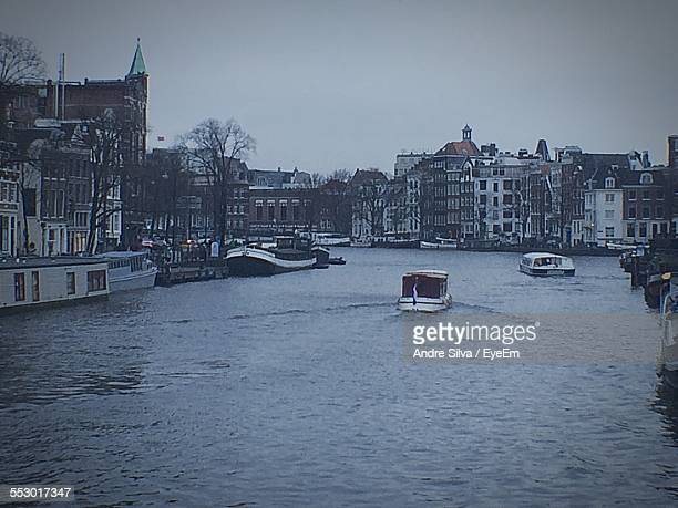 Boats In Canal Along Buildings
